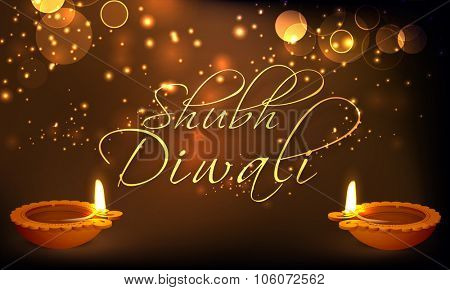Elegant greeting card design with beautiful illuminated oil lit lamps on shiny brown background for Indian Festival of Lights, Shubh Diwali (Happy Diwali) celebration.