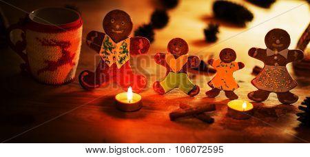 Christmas gingerbread men candles with cinnamon stars Pine twig Christmas ball