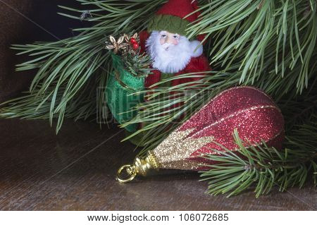 New Year's Toys Under Green Fir Tree On Dark Background