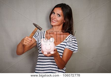Good-looking Lady Breaking Moneybox While Smiling
