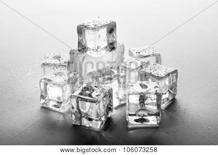 Perfect clear ice cubes on grey background