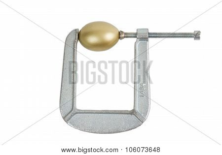 Golden Egg In Metal Clamp