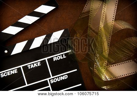 Movie Clapper Board Detail And Unrolled  Filmstrip
