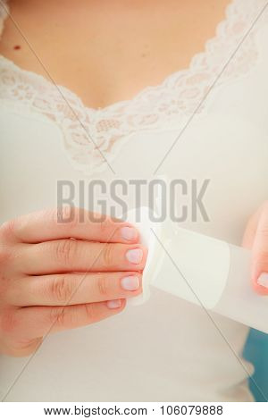 Woman Holding Cotton Swab And Makeup Remover In Hands