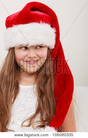 Happy Little Girl Kid In Santa Hat. Christmas.