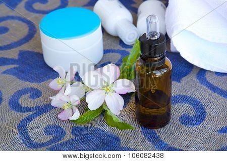 A Dropper Bottle Of Apple Blossoms Extract