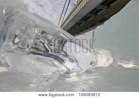 Large Chunks Of Ice Icicles Close-up Lying Under The Bridge