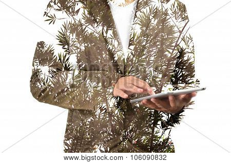 Double Exposure Of Business Man Using Mobile Tablet Pc With Plant