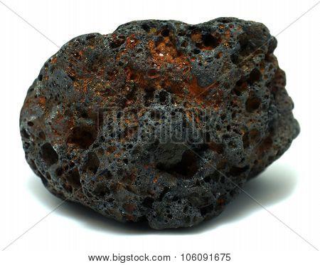 Reddish black volcanic basalt rock on white background