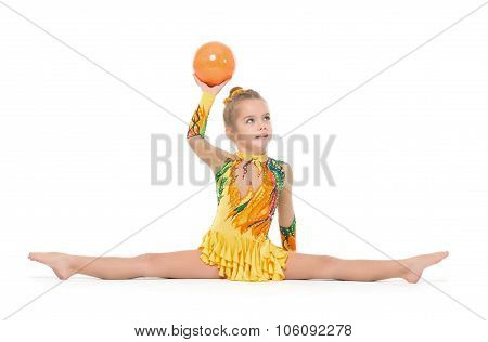 Little Gymnast Practicing With A Ball