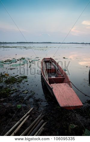 Moored Fishing Boats On Lake In Asia With Sunset Background