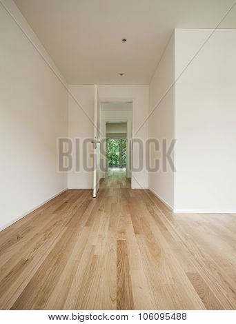 Interior modern apartment, bright room with parquet floor