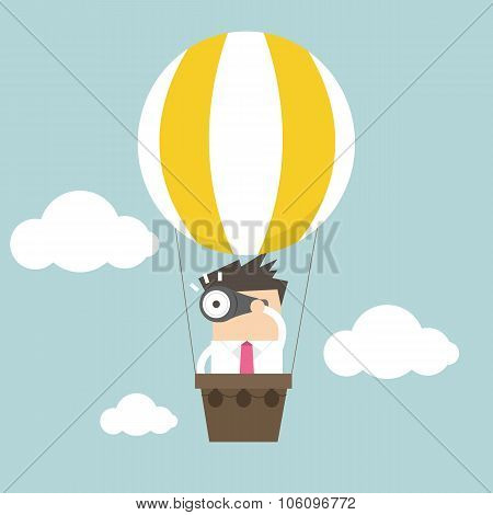 Businessman in balloon