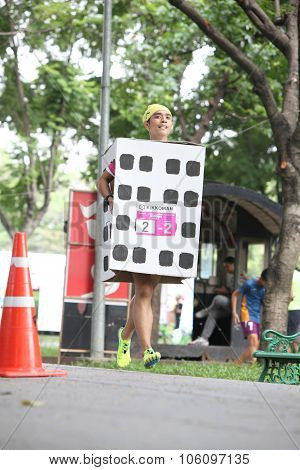 Bangkok - October 23: Unidentified Runner Participates Wearing Fancy Costume In Ekiden 2015 Marathon