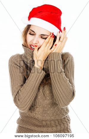 Portrait Of A Young Girl In A Santa Hat Hand On His Cheek From A Toothache