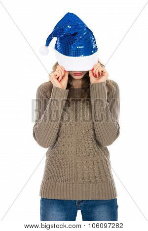 Angry Woman With A Christmas Hat Covering Her Eyes Against A White Background