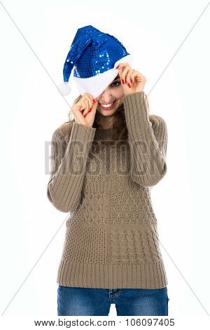 Smiling Girl With One Eye Peeking Out Of Santa Hats