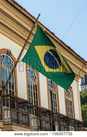 Waving Brazilian flag from a Colonial house in Ouro Preto, Brazil