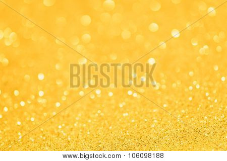 Yellow golden glittering Christmas lights. Blurred abstract background