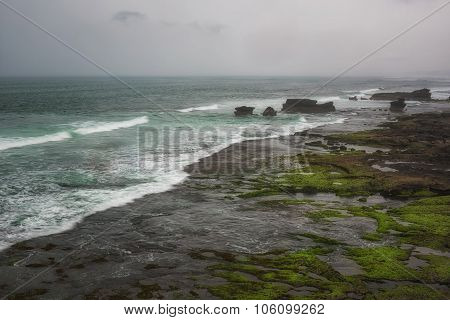 Beach near Tanah Lot during rain Bali, Indonesia.