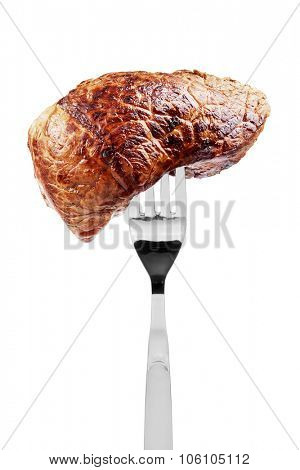 Fried beef steak pierced on a fork