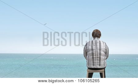 Middle aged stout woman sitting with back