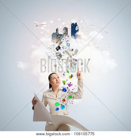 Portrait of young businesswoman in white suit reading blank newspaper
