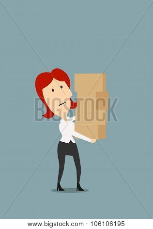 Businesswoman carrying stack of boxes