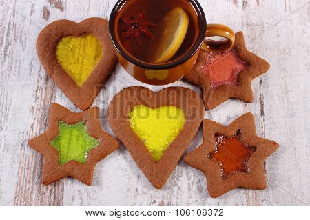 Stained Glass Gingerbread And Tea On Old Wooden Background, Christmas Time