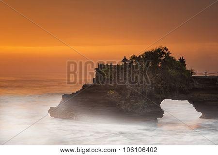 Long exposure of Hindu temple Pura Tanah Lot and sunset