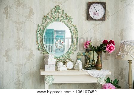 Vintage Interior With Mirror And A Table With A Vase And Flovers