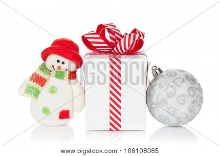 Christmas gift box, bauble and snowman toy. Isolated on white background