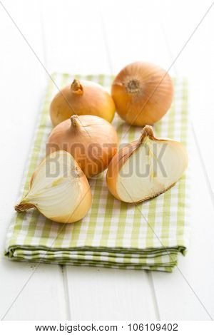halved fresh onion on a kitchen table
