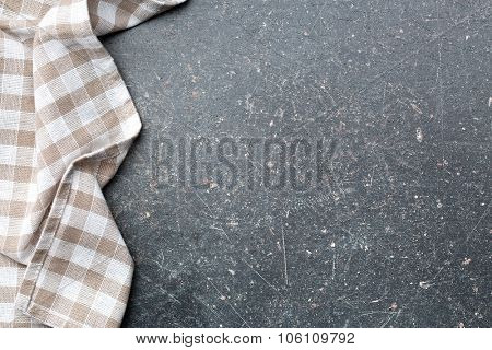 checkered tablecloth over old kitchen table