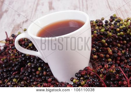 Cup Of Hot Tea With Elderberry Juice And Heap Of Berry, Healthy Nutrition