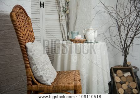 A Table Covered With Thick Cloth With A Cup Of Tea And Tea And Marshmallow In A Wicker Plate. Tea Pa