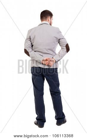 back view of Business man  looks.  Rear view people collection.  backside view of person.  Isolated over white background. Hands behind his back a man looking to the left.