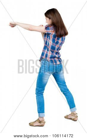 skinny woman funny fights waving his arms and legs. Isolated over white background. A young girl in a checkered blue with red stripes student punched.