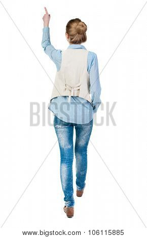 back view of walking  woman. beautiful redhead girl pointing.  backside view of person.  Rear view people collection. Isolated over white background. office worker woman going.