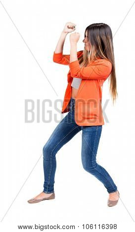 skinny woman funny fights waving his arms and legs. Isolated over white background. The girl in the red jacket standing in a boxing pose protecting her face from the blow.
