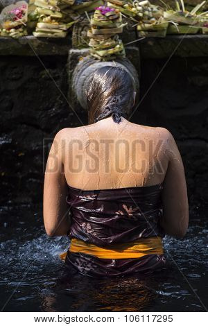 Traveller take a bath at Holy Spring Water Tirta Empul Hindu Temple , Bali Indonesia.