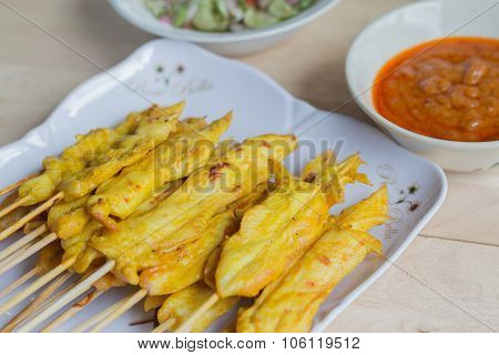 Grilled Chicken Satay With Peanut Sauce And Vinegar Of Vegetable Mix Salad