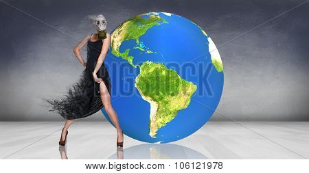 Model posing near big earth ball