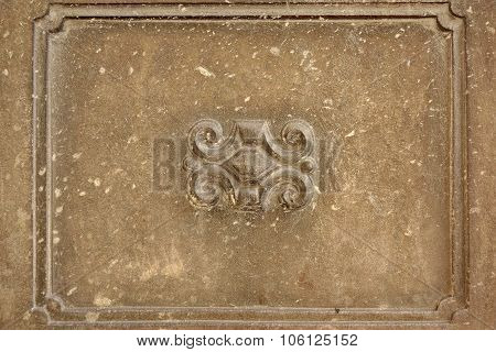 Old Concrete Wall Fragment With Handmade Frame And Bas-relief Shape