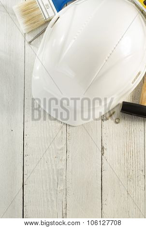 hardhat and tools on wooden background