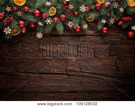 Christmas fir tree with decoration on a wooden board. Copy-space for text