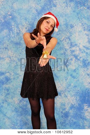 A young and cute brunette girl in a Christmas hat