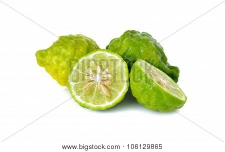 Whole And Half Cut Fresh Bergamot Or Leech Lime On White Background