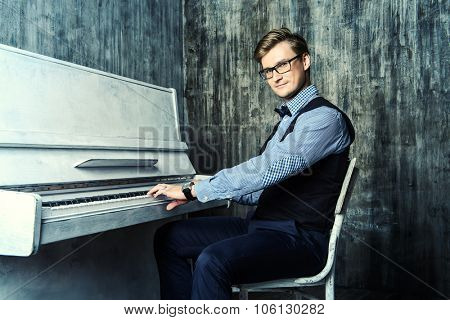 Pianist plays the piano. Art, musical concept.