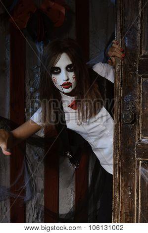 Woman In Makeup Looks From Behind The Door